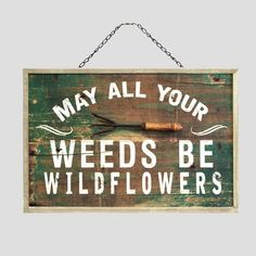 """May all your weeds be wildflowers"" wooden sign.  Perfect for the farmhouse garden.  #affiliate"