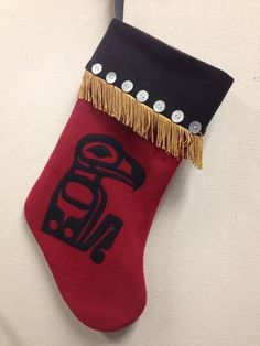 We love Tlingit artwork, clothing and accessories. Sorry to say we don't know the name of the artist who did this clever Christmas stocking.