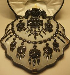 From the British Museum. A suite of mourning jewelry of Bohemian glass, dating from after 1867