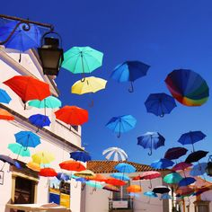Taken on one of the streets of Evora. People often hang umbrellas over the streets to create some shade during the hot days.
