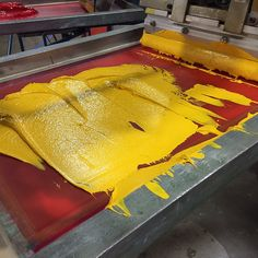 Yellow Ink Just Loaded Into a Screen   by atkinsontshirt