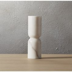 Shop pinch taper candle holder.   Smooth pillars of Banswara white marble stack a sculptural foundation for a single taper candle.