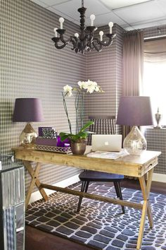 You might have heard that wallpaper is making a comeback. Bring the trend into your home office to add visual interest without crowding the space. Textured wallpaper, like brick or natural scenery, can add depth to your space. However, don't just think about using wallpaper just in the traditional sense.