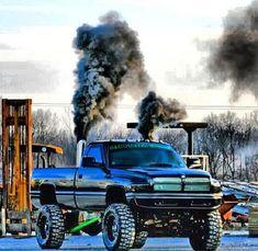 Sexy Black Second Gen Dodge Cummins Diesel Roll Coal
