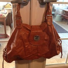 Beverly Hills Polo Club Purse Large camel-colored, loose-structure purse. Two large openings and one center zip compartment. Inside zip compartment contains a zipper and two phone pockets. Side ruching is adjustable, as shown in the picture. Beverly Hills Polo Club Bags