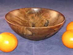 Wood-turned bowls look so great within the organic natural decorating theme.  Find a cool gear at the flea market and set the bowl on it, turn it into awesome industrial chic decor, also.  So many ways to style with these.