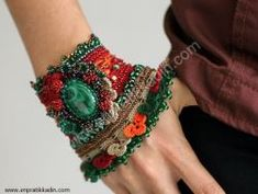 Handmade crochet cuff with malachite cab and malachite buttons. Decorated with crochet flowers and lot of glass and metal beads. The main colors are: Textile Jewelry, Fabric Jewelry, Beaded Jewelry, Handmade Jewelry, Cuff Jewelry, Freeform Crochet, Bead Crochet, Bracelet Crochet, Creation Couture