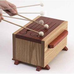 Tongue Drum Woodworking Plan — Make beautiful sounds by striking the slatted top of this six-note, easy-to-build instrument. http://www.woodstore.net/totodr.html