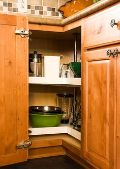 """Store small appliances, such as a coffee grinder, handheld electric mixer, and toaster, inside a cabinet on a large lazy Susan. """"A quick turn, and what you need is at your fingertips,"""" author Meryl Starr says in The Home Organizing Workbook."""
