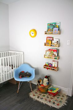 love the grey floor... chair is nice too,bright pop of colour.. modern... not comfy for long period of feeding though!