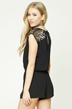 2afe5f64992c A woven gauze romper featuring floral embroidery