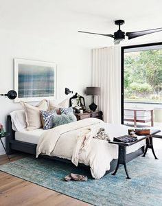 Designer Athena Calderone's Amagansett bedroom is a beautiful example of a high-low mix. She paired the IKEA Malm bed with an ABC Carpet & Home Color Reform Silk Overdyed Rug (prices begin. Ikea Malm Bed, Ikea Bedroom, Calm Bedroom, Bedroom Rugs, Ikea Nightstand, Bedside Tables, Bedroom Decor On A Budget, Bedroom Ideas, Bed Ideas