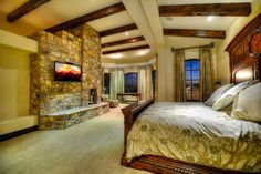 Rustic Master Bedroom with Exposed beam, Arched window, Carpet