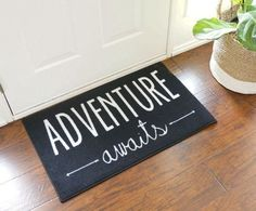 Adventure awaits door mat is 22 inches by 32 inches. Adventure Awaits indoor door mat with arrows on black background and white text. Indoor Outdoor, Welcome Door Mats, D House, H & M Home, Travel Themes, Style Vintage, Classroom Themes, Ela Classroom, Adventure Awaits
