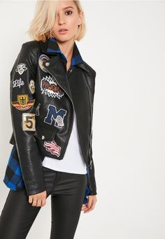 channel biker chick vibes in this badge detail badass jacket.