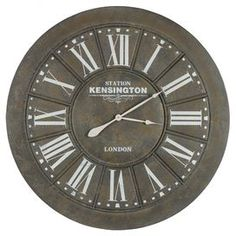"""Add vintage-chic appeal to your home office or kitchen with this gently distressed metal wall clock, showcasing bold Roman numerals and an understated design.  Product: Wall clockConstruction Material: MetalColor: Black crackle, brown and whiteFeatures:  Roman numeral faceGently distressedAccommodates: Batteries - not includedDimensions: 39"""" Diameter"""