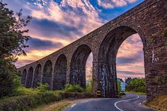 Greenway Waterford, Ireland   Cycling along the old railway line of the Waterford Greenway, the Mahon Viaduct looms on the horizon, each of its eight arches perfectly framing the skyline beyond. Built in 1875, just 30 years after the Great Famine, the viaduct today towers steadily, a trusty testament to the quality of 19th century engineering and masonry.