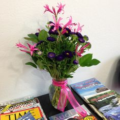Pretty in pink and purple arrangement from our favorite florists!