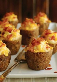 Roasted Garlic Twice Baked Potatoes -- Fresh roasted garlic swirled into baked potato with Velveeta and Parmesan then baked again. You'll be thanked every time these cheesy delights appear at the dinner table.