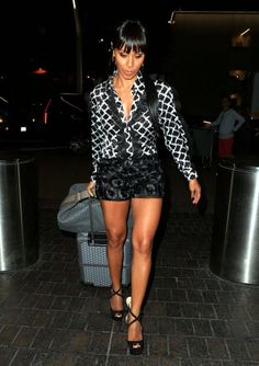 Hot! Or Hmm…: Jada Pinkett Smith's LAX Airport Emanuel Ungaro Spring 2016 Black and White Mesh Detail Long Sleeve Printed Shirt And Floral Motif Shorts