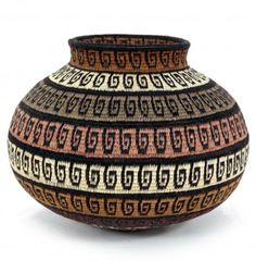 Bands of rich browns and ochre's encircle this rounded basket, each decorated with black swirling waves.