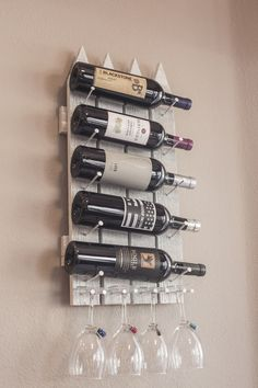 "Wooden wall mounted Wine rack made to resemble a picket fence. Carefully hand crafted in the USA. - Wine storage for 5 bottles and 4 glasses. - Size: 12""x 24""x1.5"" - Created with a rustic, modern and refined charm. Adds character to any home. https://www.etsy.com/listing/185881161/handmade-wine-rack-unique-5-bottle-4?ref=listing-shop-header-2"