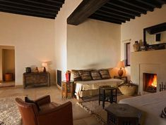 Hotels & Lodging: Kasbah Bab Ourika in Morocco : Remodelista - Love the dark wood beams Morrocan Decor, Fireplace Seating, Moroccan Design, Moroccan Style, Hotel Lounge, Beautiful Places To Live, Interior Decorating, Interior Design, Common Area