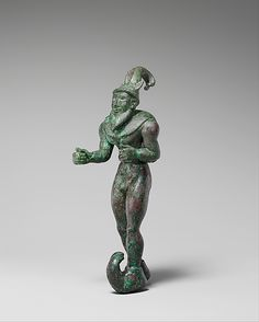 Striding figure with ibex horns, a raptor skin draped around the shoulders, and upturned boots Period: Proto-Elamite Date: ca. 3000 B.C. Geography: Mesopotamia or Iran Culture: Proto-Elamite Medium: Copper alloy Dimensions: H. 17.5 cm (6 7/8 in.) W. 5.4 cm ( 2 1/8 in.)