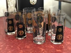 Eight Gold And Black Bar Glasses   $32  Mid Century Dallas, Oak Cliff  Booth #766  Lula B's in the OC! 1982 Ft. Worth Ave. Dallas, TX 75208 Mid Century Bar, The Oc, Mid Century Furniture, Cliff, Pint Glass, Neiman Marcus, Dallas, Glasses, Gold