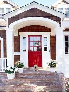Ensuring that there are cohesive accents throughout the outside of your house is key for maintaining curb appeal. Check out this house's matching white trim and plant containers.