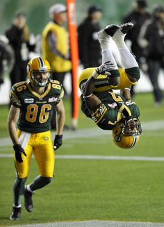 Picture Perfect Photography: Edmonton Eskimos' Hugh Charles (R) flips in front of Matt Carter