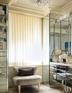 Trisha Reger designed the mirror-surfaced cabinetry in Candice Stark's bath; the chair was custom made.