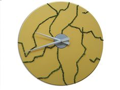 """Prestotardi"" is a wall clock in varnished MDF in five different colors. The preserved Northern Lichen adorns the wall clock with curvy shapes, inspired by river flows. Its minimal design is perfect for offices, banks and boutique. http://bit.ly/prestotardi-clock ‪#‎design‬ ‪#‎clock‬ ‪#‎office‬ ‪#‎furniture‬ #linfadecor"