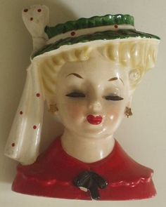 Woman Head Vase Year: 1961-My grandmother was a florist and I loved looking at these-they wore earrings!