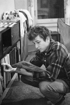 BOB DYLAN by JOE ALPER - BOB DYLAN, in new York, 1962 BOB DYLAN inspects the record collection of Alper, 14 January 1962.