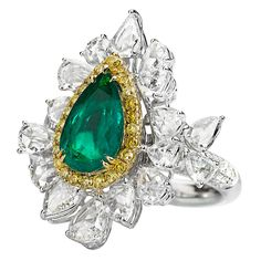 Ring by Avakian - yellow and white diamonds and a pear-cut emerald
