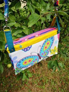 Triple pochette ChaChaCha à papillons colorés cousu par Elise - Patron Sacôtin