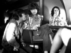 """Jimmy Page, BP Fallon and """"The Sun's"""" Bob Hart (kneeling) aboard Led Zeppelin's private jet, """"Starship"""""""