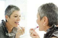 Must Read Makeup Tips for Women Over 50: older woman applying lipstick..make up and beauty tips for seniors