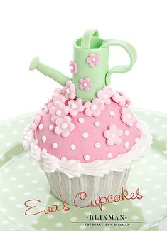Adorable cupcakes with flowers and a watering can...repinned by: Beneva Flowers - Sarasota, FL