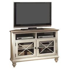 Add country-chic appeal to your living room or den with this weathered ash wood media console, showcasing 2 open shelves, 2 glass doors with cross overlays, and a space-saving corner design.  Product: Media consoleConstruction Material: Ash wood, glass and ash wood veneersColor: Weathered driftwood and dover whiteFeatures:  Two doorsX-shaped accentsTwo adjustable interior shelves Wire management Ventilation slots Tip restraining hardware Base levelersTwo open compartmentsBun feet  ...