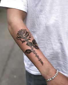 Who does not love a rose and find it simply and stunningly beautiful? Maybe men might consider themselves too masculine to wear one of these flowers tattooed on their bodies, but, women swear by it. Rose tattoo designs are easily… Continue Reading → Small Tattoos Men, Rose Tattoos For Men, Black Rose Tattoos, Arm Tattoos For Guys, Simple Mens Tattoos, Black Rose Tattoo For Men, Tattoo Black, Tattoo Small, Hand Tattoos