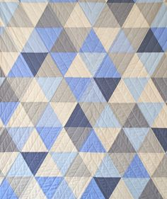 http://www.etsy.com/listing/73413241/equilateral-triangles-throw-quilt-made