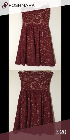 Deb dress Maroon lace and beige underneath dress. Gently used worn once. Deb dress. Strapless. Maroon Lace with beige underneath. Above the knee. Perfect for a date or a night out. No zipper stretches to fit around breast and arm area. Very comfortable. Elegant. Also perfect for fall. Deb Dresses Midi