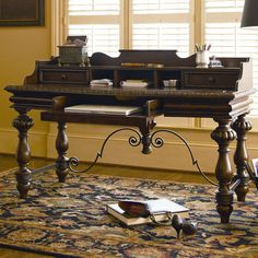 Old World-inspired writing desk with turned legs. Features 3 drawers and a lift-top lid. Product: Writing deskConst...