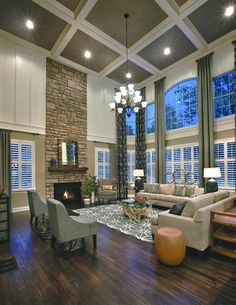 Stunning two-story family room at the Elkton South Shore model home at Estates at Cohasset, Massachusetts