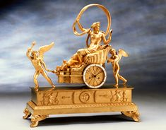 An Empire gilt bronze chariot clock by Louis Moinet housed in a case by Pierre-Philippe Thomire. Paris, circa 1815-1820
