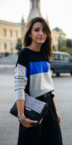 Alexandra Pereira is wearing a black, blue and grey colour block jumper from M&S