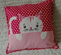 Children's Cat cushion with filling. The head and paws and tail are a combination of the application of fleece and machine embroidery.