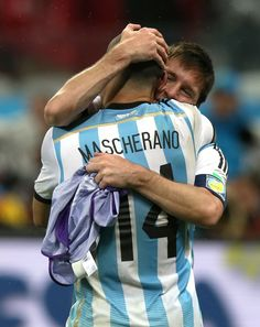 Javier Mascherano and Lionel Messi of Argentina celebrate the fact they are through to the Finals of the 2014 FIFA World Cup